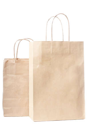 Two paper bags isolated over white background photo