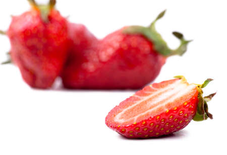 Macro view of fresh strawberries over white background photo