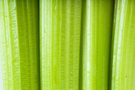 Macro view of fresh green stems of celery photo