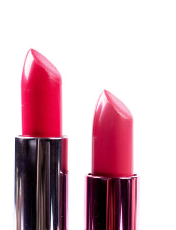 Red lipsticks isolated over white background photo