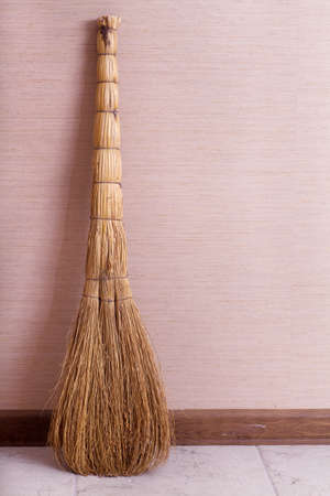 Whisk broom standing in empty room photo