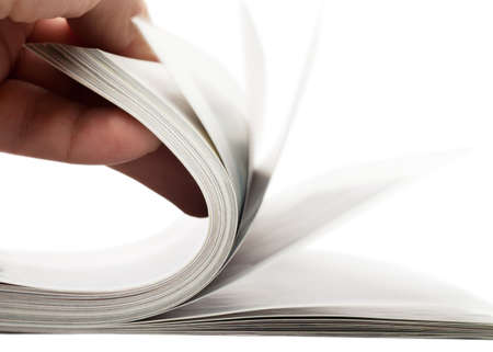 Turning over pages of thick magazine Stock Photo