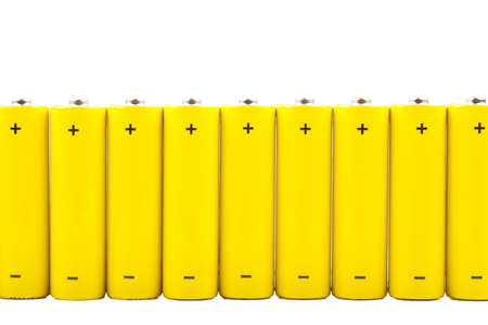 A row of yellow batteries isolated over white background Stock Photo - 15081084