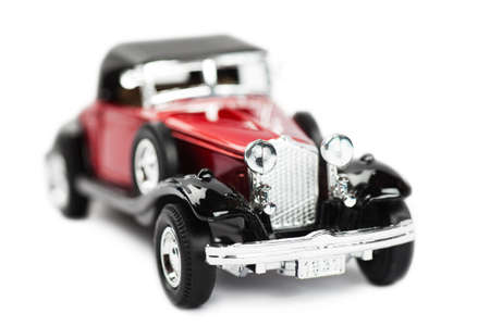 Macro view of toy car over white background photo