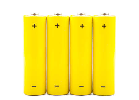 Four yellow batteries isolated over white background Stock Photo - 15152553