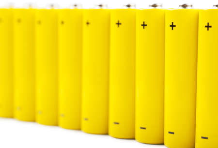 A row of yellow batteries isolated over white background Stock Photo - 15286305