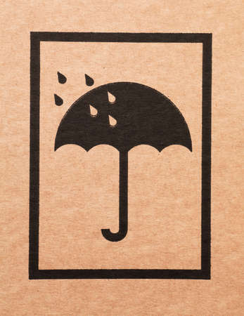 An umbrella sign on a cardboard box photo