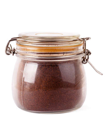 grinded: Glass jar with grinded coffee isoalted over white background Stock Photo