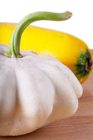 Pattypan and marrow vegetables on a wooden table photo