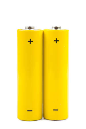 Two yellow batteries isolated over white background Stock Photo - 15892792