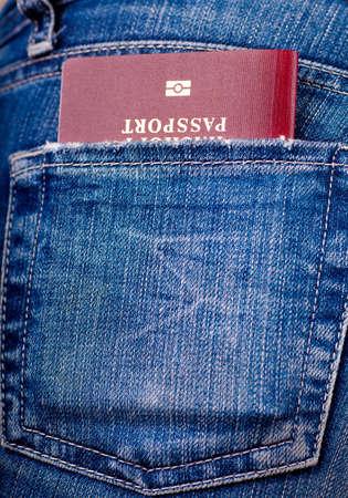 Closeup view of a denum pocket with a passport Stock Photo - 16038283