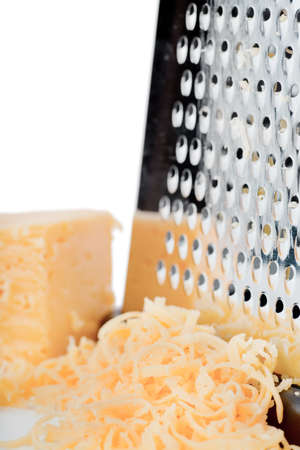 Closeup view of grater and grated cheese photo