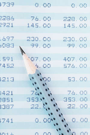 Closeup view of lead pencil on a financial report photo