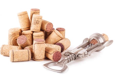 big cork: Closeup top view of wine corks and corkscrew over white background