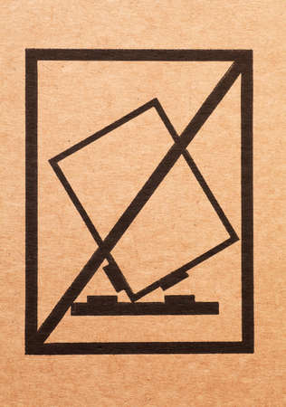 Handle with care sign on a cardboard box Stock Photo - 17305587
