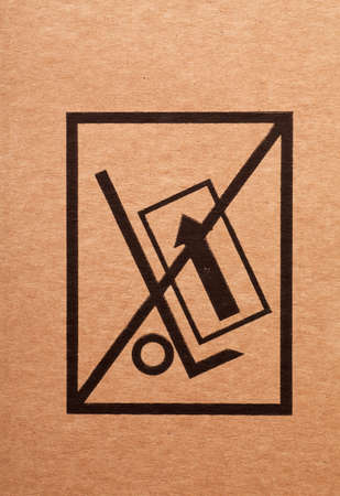 Handle with care sign on a cardboard box photo