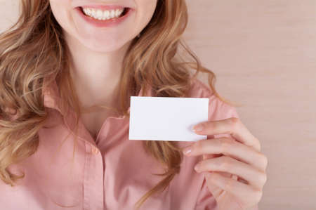 Image of smiling business woman holding her visiting card photo