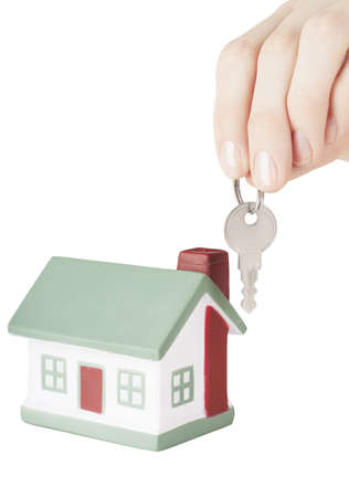 Little house toy and hand with key isolated over white background Stock Photo - 17741318