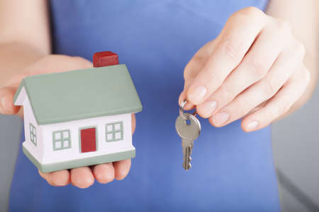 Little house toy and a key in woman photo