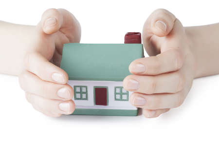 Little house toy covered by hands over white background Stock Photo - 17899030