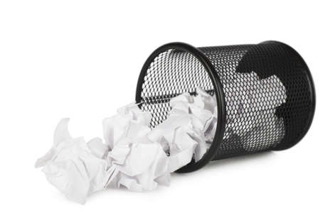 meaningless: Trash can filled with crumbled paper canted on a side isolated on white background