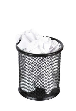 meaningless: Trash can filled with crumbled paper isolated on white background
