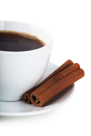 Cup of coffee and cinnamon over white background