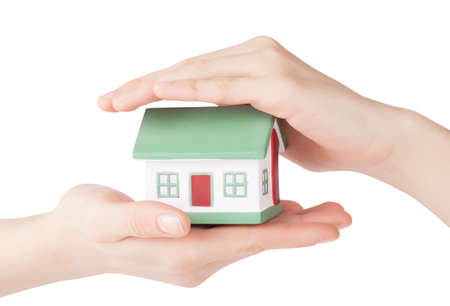 Little house toy in hands isolated over white background Stock Photo - 18375153