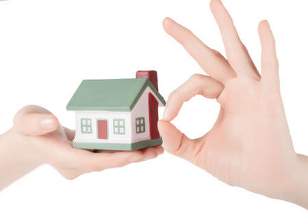 Little house toy in woman hands isolated over white background Stock Photo - 18678703