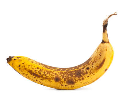 Single overripe banana isolated over white background