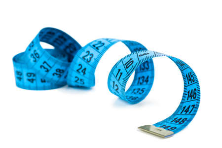 Closeup view of blue measuring tape isolated over white background Фото со стока