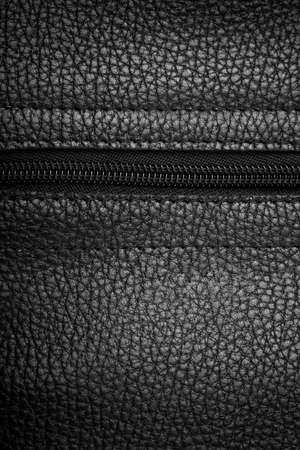 forniture: Macro view of black leather background with zipper Stock Photo
