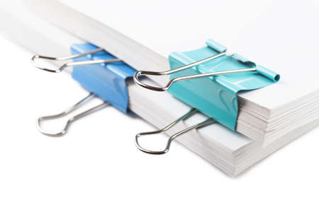 seperator: Closeup view of blue metal clips on white paper Stock Photo