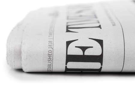 Closeup view of folded newpaper over white background Standard-Bild