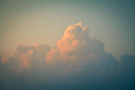 Cumulus clouds at dawn. Toned image photo