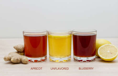 Kombucha. drinks of different colours and textures in glass cups on table. A place for a label. Copyspace 스톡 콘텐츠