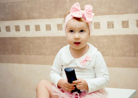 girl with a remote 스톡 콘텐츠