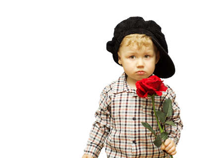 Cute baby with a rose in his hands. Banque d'images