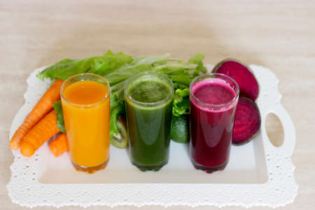 Vegetable smoothies detox - Carrot, beet and green salad. Vegetarian Organic Food. Freshly squeezed juice cocktail. Closeup