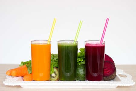 Vegetable smoothies detox - Carrot, beet and green salad. Vegetarian Organic Food. Freshly squeezed juice cocktail. Copyspace