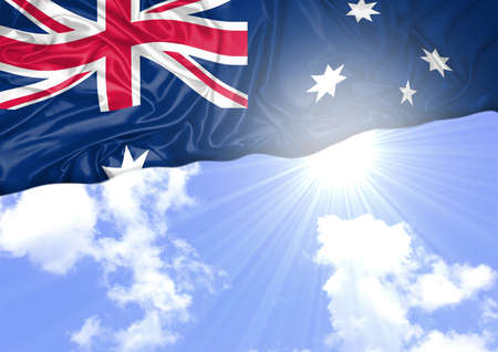 National flag of Australia hoisted outdoors with sky in background. Australia Day Celebration. Front view Stok Fotoğraf