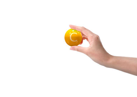 woman hand holding vitamin c capsule, orange color, on white background. Copy space. 3D rendering