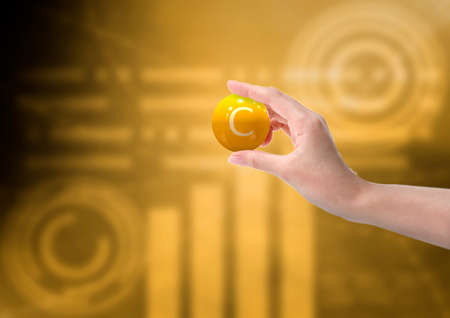 woman hand holding vitamin c capsule, orange color, on background with graph. Copy space. 3D rendering
