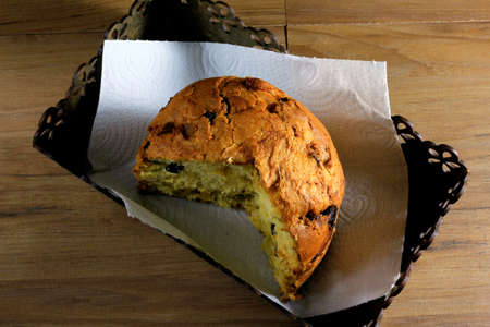 closeup panettone inside box on wooden table, top view