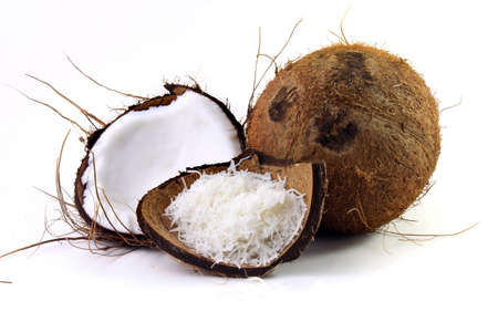 fresh coconut flakes placed in bark and shell isolated on white background. Front view