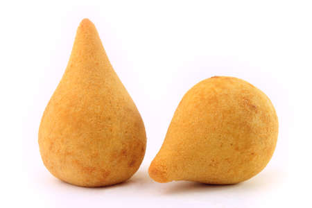 Coxinha, traditional Brazilian cuisine snacks stuffed with chicken, isolated on white background. Close up