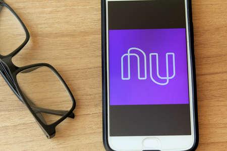 Rio de Janeiro, Brazil - December 22, 2019: Nubank logo on the mobile screen. It is a pioneer Brazilian startup in the financial services segment based in São Paulo