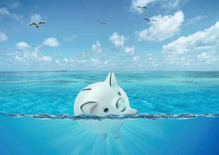Safe pig sinking in the high seas. concept of financial failure. Front view Stok Fotoğraf
