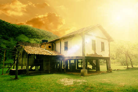 closeup of farm house in the landscape during sunset. Front view