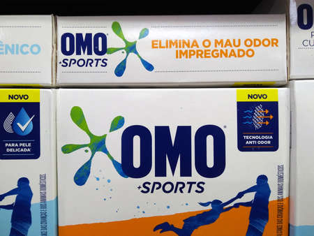 RIO DE JANEIRO, BRAZIL - DECEMBER 27, 2019: OMO boxes on the Brazilian supermarket shelf. It is a brand of washing powder from the multinational company Unilever.
